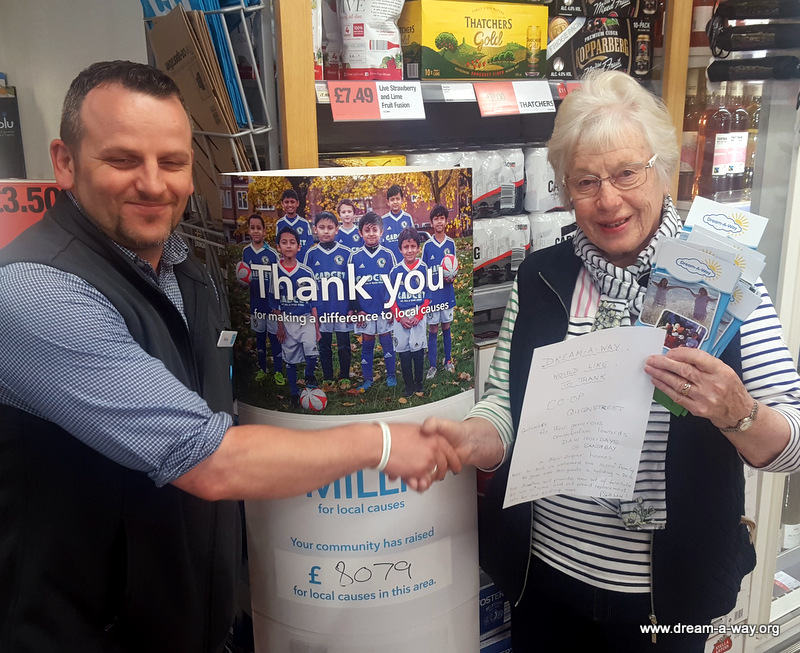 Our Ruth collecting a cheque from Co-op Exeter