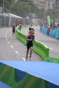 Photo of David Hill running in 2016 Rio Triathlon