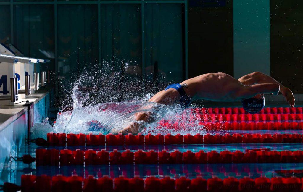 Photo of David's backstroke start.