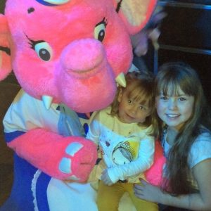 Photo of Harper and Aayla having their picture taken with Anxious the Elephant at the sensory stay and play