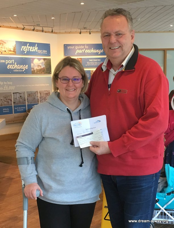 Photo of Michelle presenting cheque to Jeff Merrett MBE of Dream-A-Way