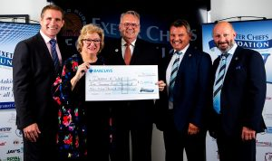 Photo of DAW Chairman Jeff Merrett MBE and management committee team member Paula Stacey at the awards ceremony at the home of the Chiefs receiving a cheque for £5859.43 from rugby legend Phil Vickery MBE