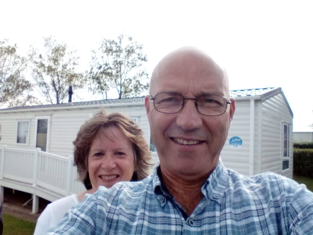 Kent and Elaine in front of their Dream-A-Way holiday home for the week