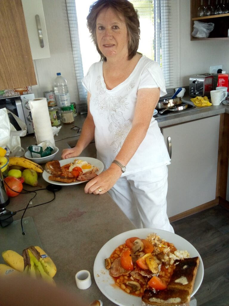 Elaine in the holiday home ready to enjoy her full English breakfast